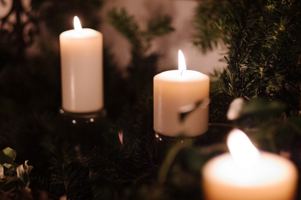 three candles in a Christmas tree