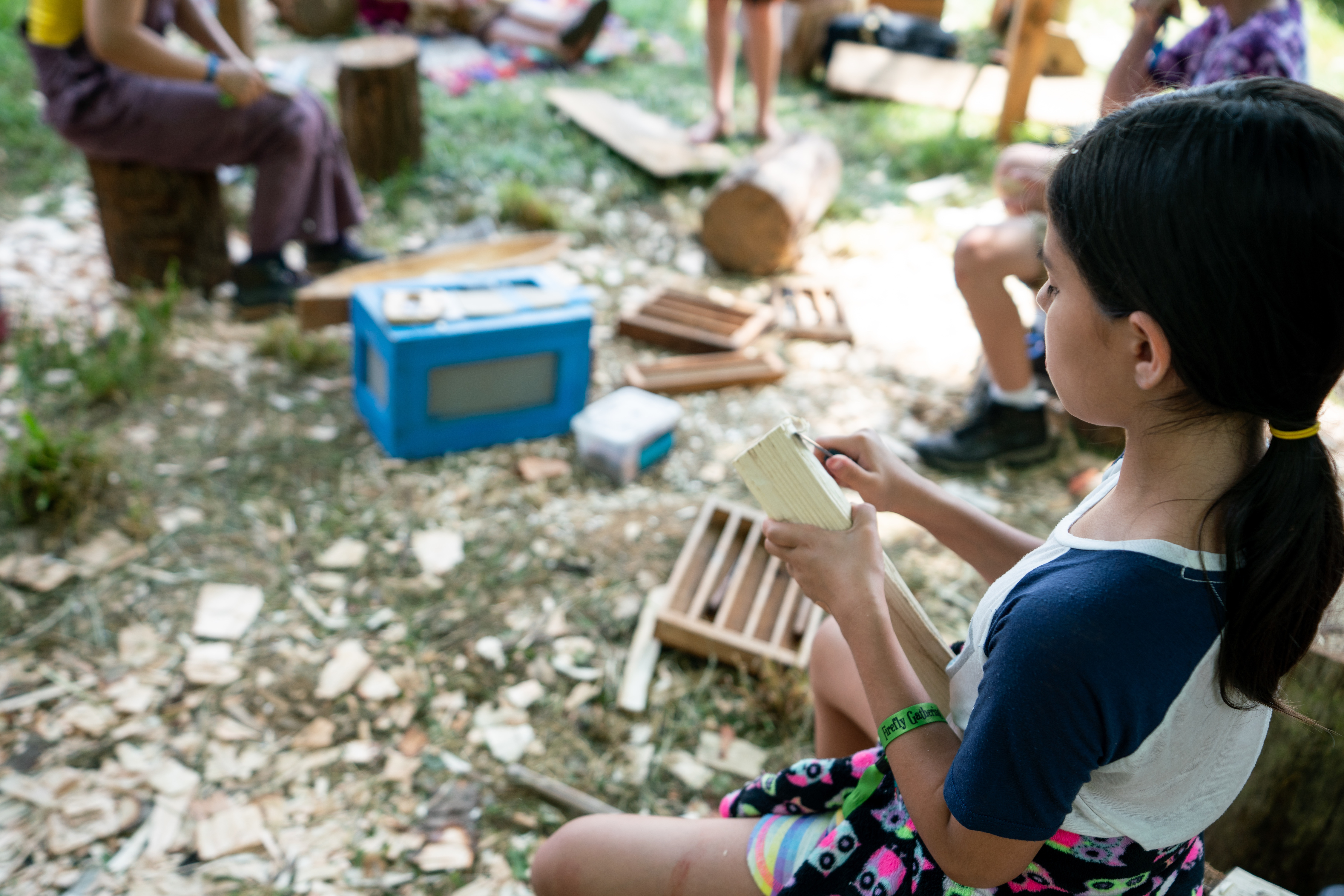 child carving wood