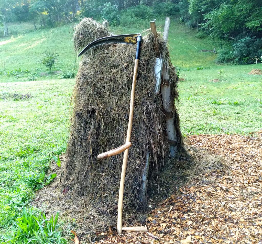 scythe and haystack of Johnny Baer